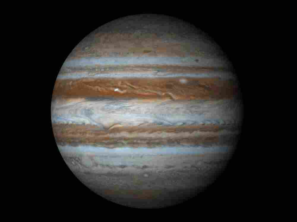 Displayed as a proper sphere, Jupiter shines like a jewel in the night, a giant pillar of color and power that towers above everything in solar system besides the sun itself.