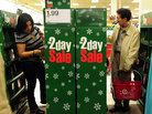 Shoppers browse through items on sale at a Target store in Rosemead, east of Los Angeles on November 25, 2011. Numbers indicate a strong Black Friday despite the weak economy. We'll recap the start to the shopping season in today's first hour. AFP PHOTO / Frederic J. BROWN