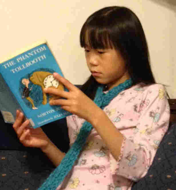 Sophie Hopp, 8, of Maple Valley, Wash., is reading The Phantom Tollbooth for the first time — it was one of her older brother's favorite books.