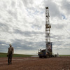Austin Mitchell walks away from an oil derrick outside Williston, N.D. With what many are calling the largest oil boom in recent North American history, temporary camps to house the huge influx of workers now dot the sparse North Dakota landscape.