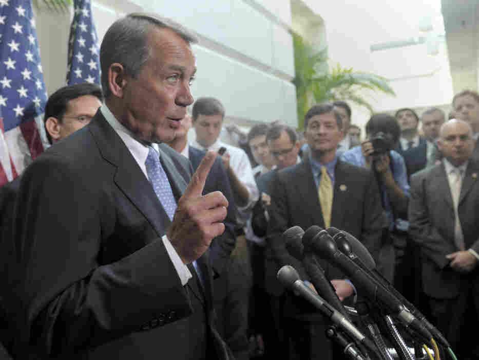 House Speaker John Boehner speaks to reporters after a closed-door GOP meeting, Wednesday, Nov. 30, 2011.