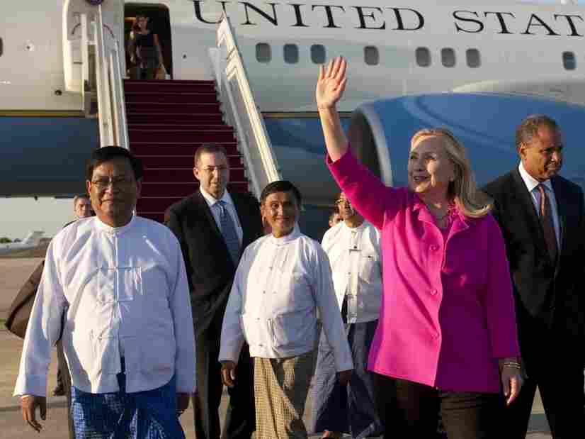U.S. Secretary of State Hillary Clinton (C) walks on the tarmac upon her arrival in Myanmar on Wednesday. Clinton arrived on the first top-level US visit for half a century.