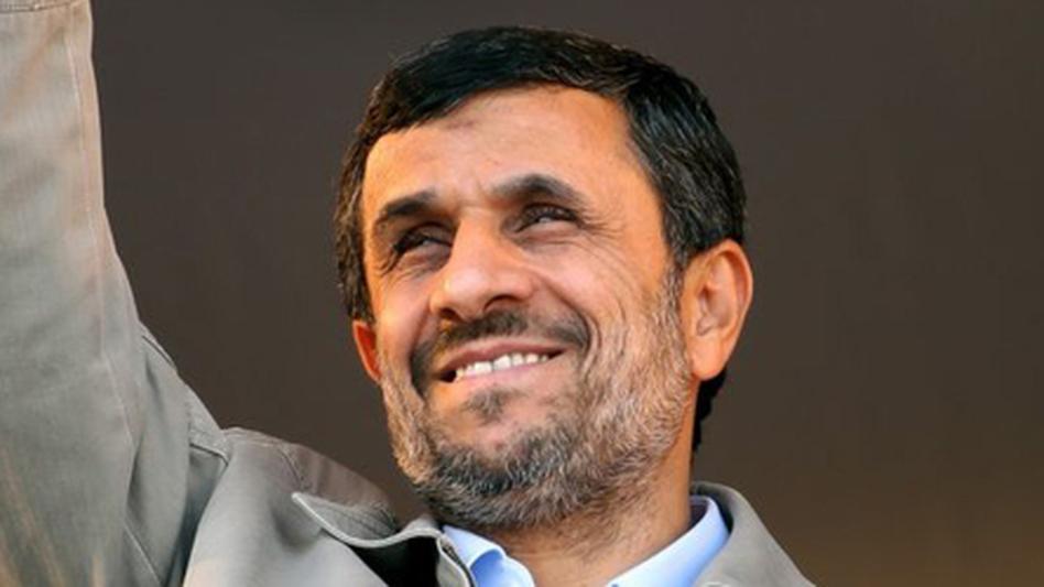 Iranian President Mahmoud Ahmadinejad waves in Pakdasht, southeast of Tehran, Nov. 23. Ahmadinejad on Wednesday said he was surprised at European moves to isolate Tehran's central bank.  (Reuters/Landov)