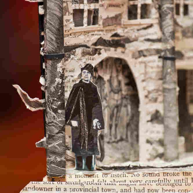Book sculpture man standing outside
