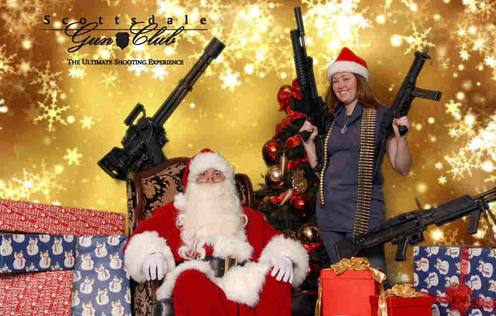 The Scottsdale Gun Club says it got the idea for the photo op last year when a club member happened to come in dressed as Santa.