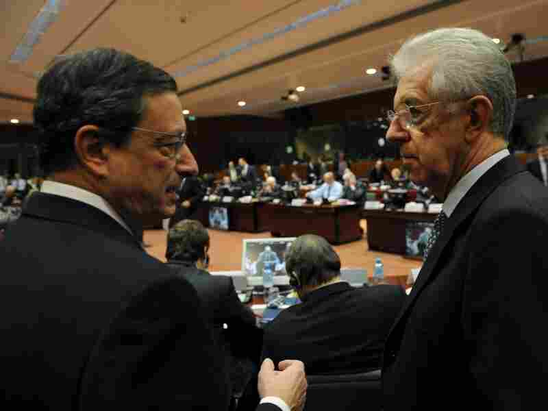 European Central Bank Chief Mario Draghi speaks with Italian Prime Minister Mario Monti at EU headquarters in Brussels on Wednesday. European leaders will meet there next week to discuss their options for fixing the region's sovereign debt crisis.