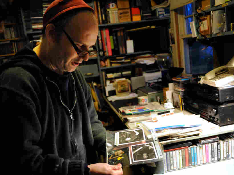 Ian MacKaye examines some fan-submitted live photos in his home office.