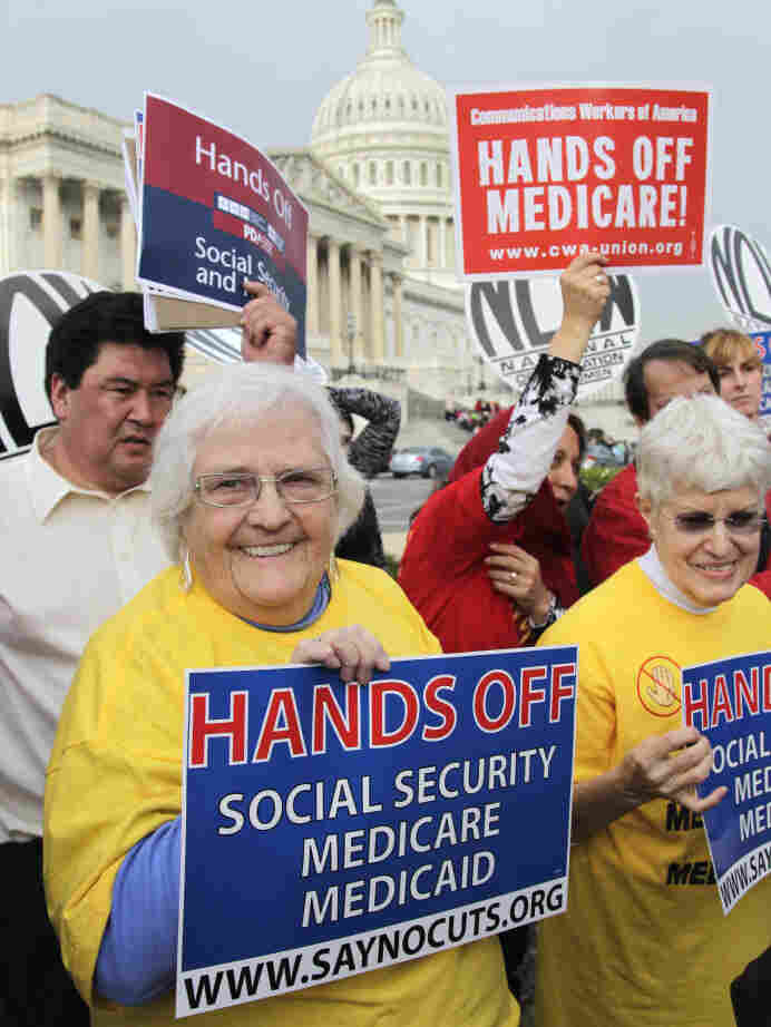 Protesters, joined by members of Congress, voiced their opposition to any cuts in Medicare, Medicaid and Social Security benefits on Oct. 26 in Washington.