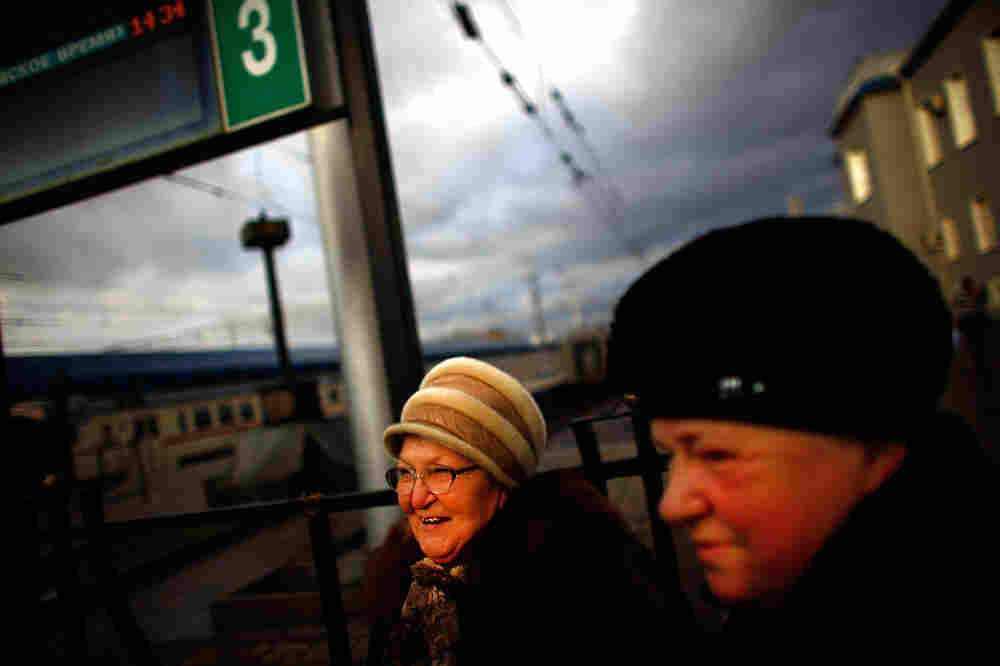 Tamara Ostrovskaya (left) and her sister-in-law, Albina Ostrovskaya (right), stand on the train platform at Yaroslavsky Rail Terminal in Moscow.