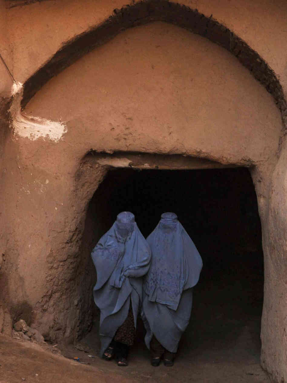 Afghan women in the northwestern city of Herat. Women still have few rights and can end up in jail on adultery charges when they accuse a man of rape. There are fears that women's rights will be further eroded when Western troo