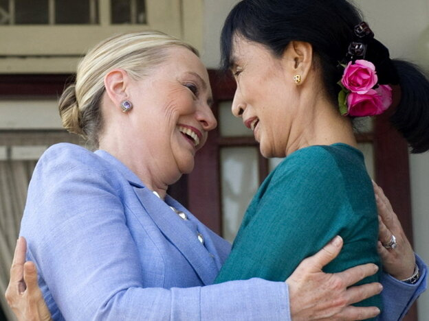 Aung San Suu Kyi, right, and Secretary of State Hillary Rodham Clinton embraced today when they met at Suu Kyi's home in Yangon, Myanmar (also known as Burma).