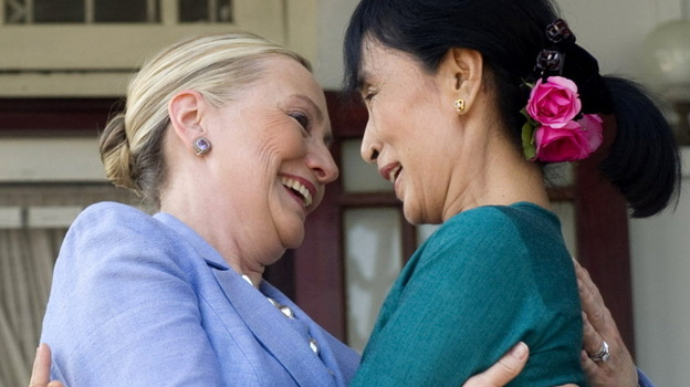 Aung San Suu Kyi, right, and Secretary of State Hillary Rodham Clinton embraced today when they met at Suu Kyi's home in Yangon, Myanmar (also known as Burma). (AP)