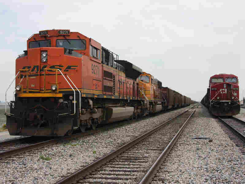 A BNSF train delivers coal.