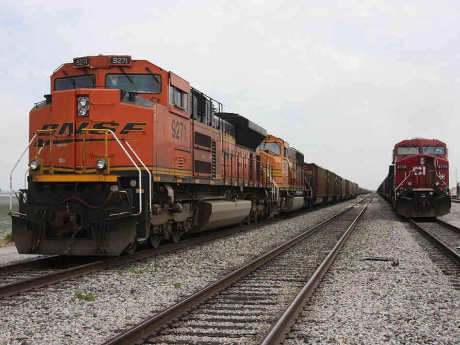 A BNSF train delivers coal.