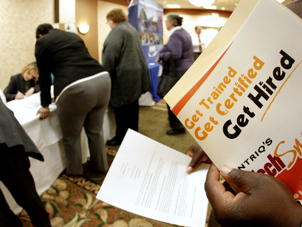 Job seekers attend a career fair in Overland Park, Kan., Dec. 1, 2011.