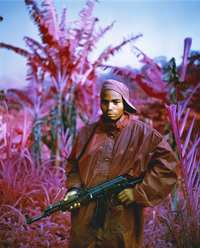 Infrared Kodak film renders certain colors in magenta. Many rebels still roam the countryside of the Democratic Republic of Congo, which has been plagued by violence for much of the past 15 years, including this fighter in North Kivu, in the far east of the country. (She Brings the Rain, 2011)