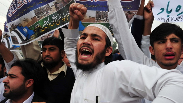 The airstrikes that killed 24 Pakistani soldiers have sparked protests. In Peshawar, Pakistan, on Thursday students shouted anti-U.S. slogans. (AFP/Getty Images)
