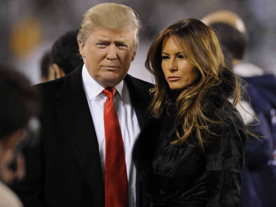 Donald Trump and his wife Melania Knauss Trump on the sidelines before a New York Jets-New England Patriots game in November.