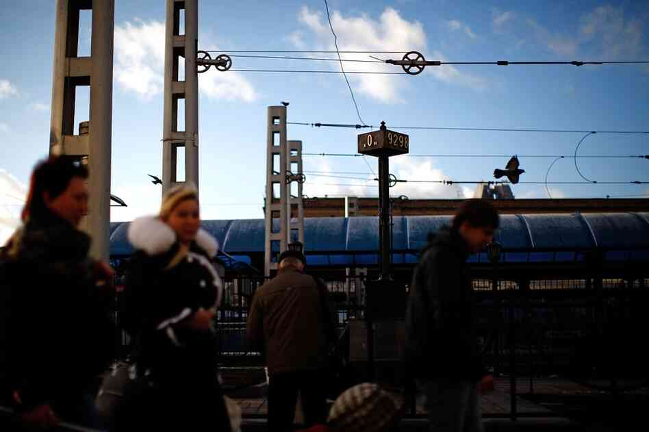 "Passengers rush past the ""0"" marker signifying the start of the Trans-Siberian railroad on the loading platform at the Yaroslavsky Rail Terminal in downtown Moscow. The Trans-Siberian rail line starts at this station and snakes its way across Russia through the country's major cities, ending at the Pacific Ocean."