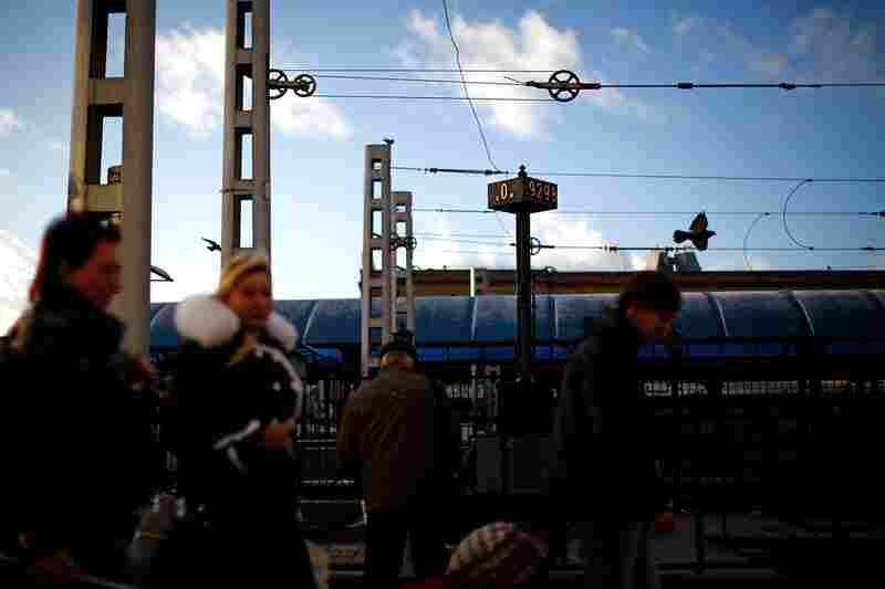 """Passengers rush past the """"0"""" marker signifying the start of the Trans-Siberian railroad on the loading platform at the Yaroslavsky Rail Terminal in downtown Moscow. The Trans-Siberian rail line starts at this station and snakes its way across Russia through the country's major cities, ending at the Pacific Ocean."""
