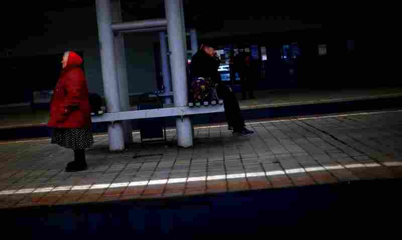 Passengers wait on a train platform at Yaroslavsky Rail Station in Moscow.