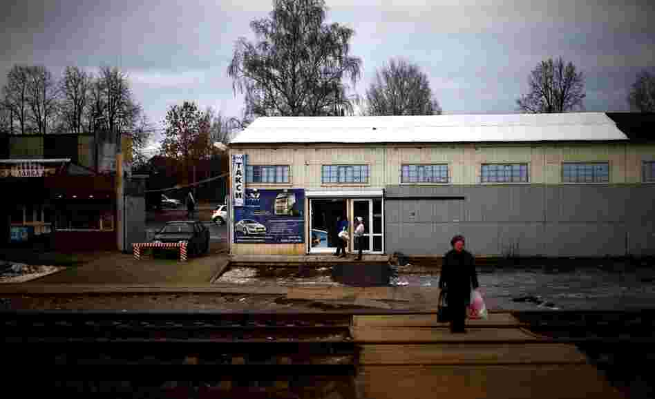 A woman waits for a local train at a small station along the Trans-Siberian railroad.