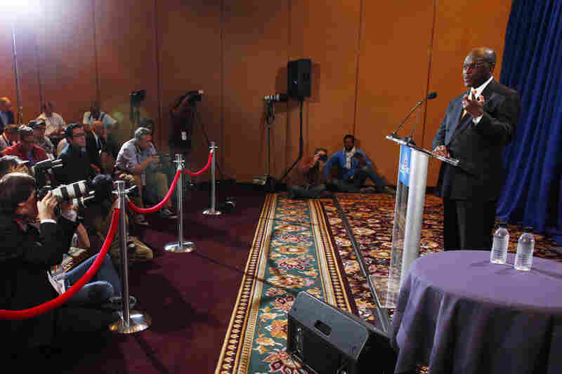 Cain speaks at a Nov. 8 press conference addressing four accusations of sexual harassment. Nearly three weeks later, on Nov. 28, Ginger White also came forward, saying that she and Cain had a consensual 13-year affair. Cain denied any inappropriate behavior.