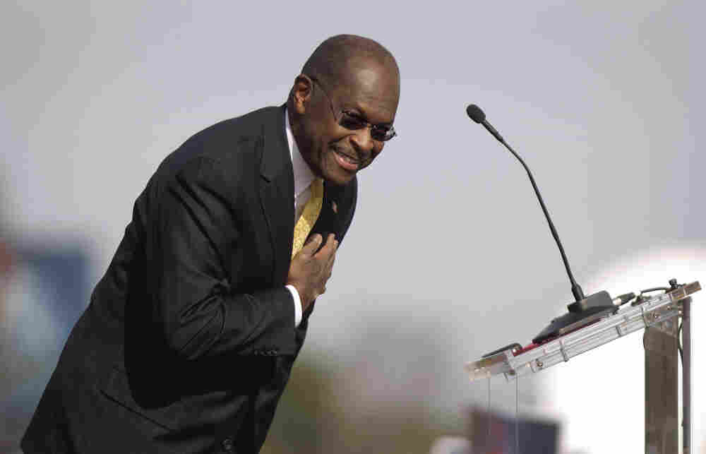 Herman Cain bows to the crowd during his announcement Saturday that he's suspending his campaign.