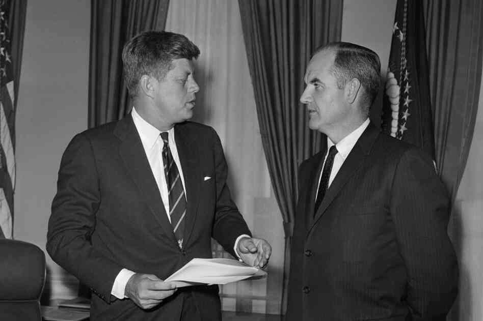 President John F. Kennedy talks with McGovern, at the time a special presidential assistant and director of the Food for Peace program, at the White House in 1961.