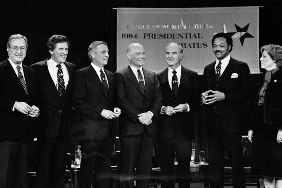 McGovern (third from right) ran for president again in 1984. He conceded his race to Democratic nominee Walter Mondale (third from left). Here, moderator John Chancellor (left) stands with five of the candidates for the Democratic nomination prepare a debate.