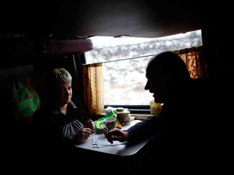 Janna Rutskaya (left) is a passenger on the Trans-Siberian train. She's on a nonstop, five-day trip from Moscow to her home, Chita, in Russia's Far East. The long train rides, she says, are a time to relax and indulge in a favorite pastime — reading detective novels. And she loves the camaraderie.