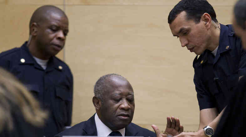 Former Ivory Coast President Laurent Gbagbo is surrounded by guards at the International Criminal Court in The Hague, Netherlands.