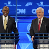 Former House speaker Newt Gingrich (right) and Herman Cain during a Republican presidential debate Nov. 22, 2011, in Washington, D.C.