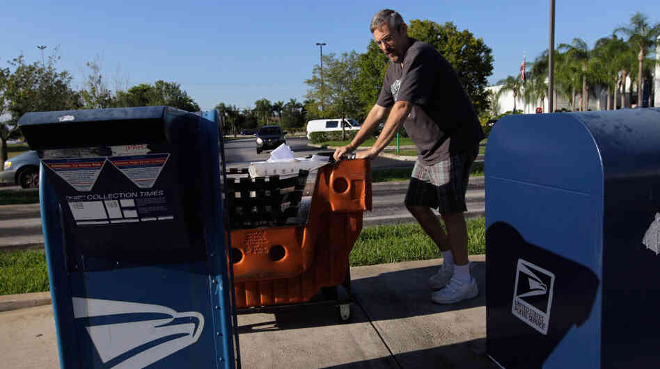 Scott Schechter, a United States Postal Service employee, collected mail from the boxes in front of a mail processing center on Sept. 16, 2011 in Pembroke Pines, Fla.