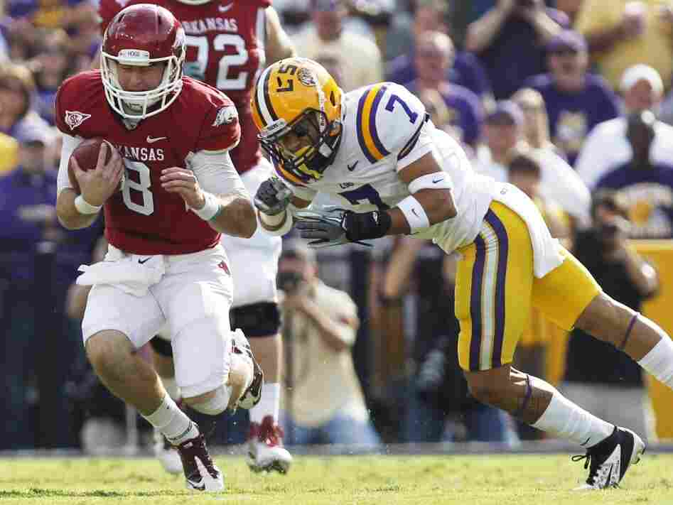 """LSU cornerback Tyrann Mathieu (right) earned the nickname """"Honey Badger"""" for hits like this one, against Arkansas quarterback Tyler Wilson on Nov. 25, 2011. Mathieu is one of five finalists named Monday for the Heisman Trophy."""