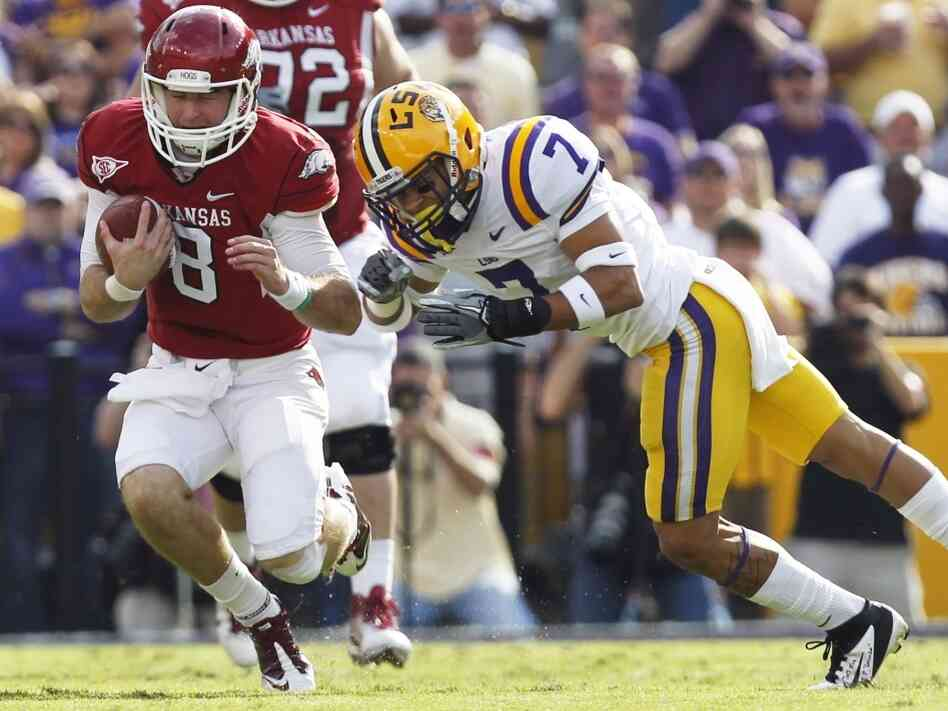 "LSU cornerback Tyrann Mathieu (right) earned the nickname ""Honey Badger"" for hits like this one, against Arkansas quarterback Tyler Wilson on Nov. 25, 2011. Mathieu is on"