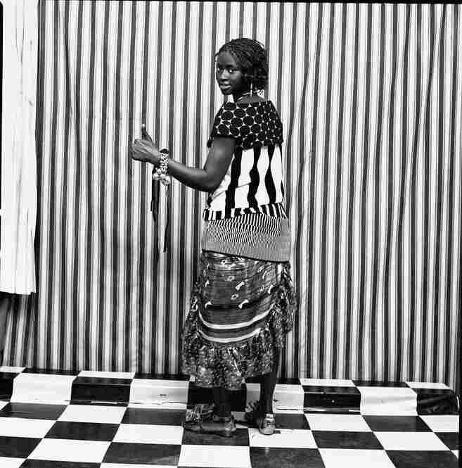 Assitan Sidibe in Marni polka-dot top, Christian Lacroix striped top, Marc Jacobs dress, and Christian Louboutin. Malick Sidibe, Courtesy Andre Magnin