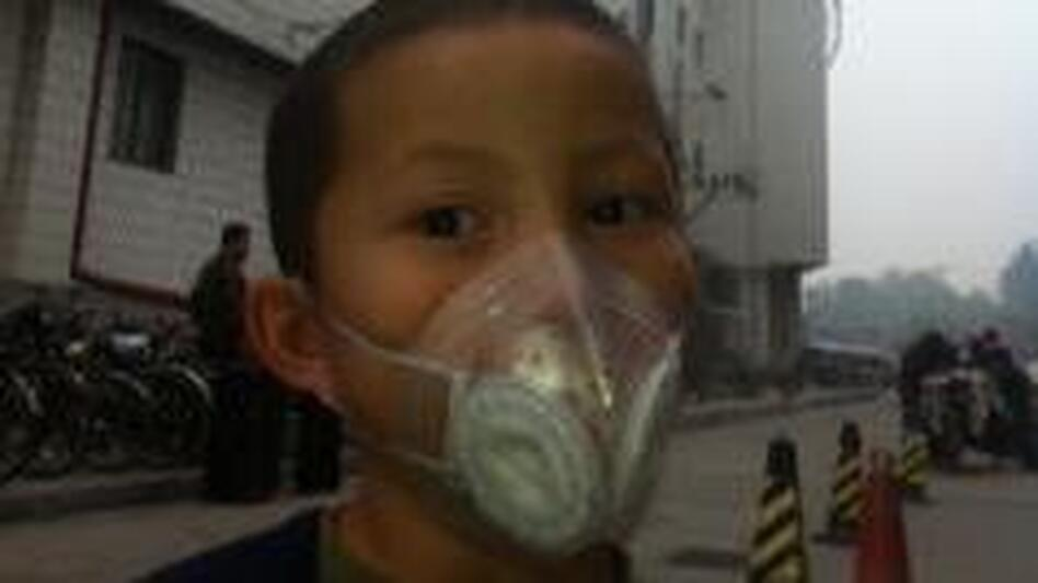 On a recent day, NPR correspondent Louisa Lim's 6-year-old son, Daniel, wears a protective mask outside. (NPR)