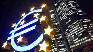 The building of the European Central Bank at night.