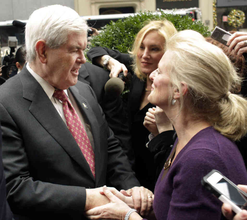 Speaker Newt Gingrich speaks with a supporter in New York City, Monday, Dec. 5, 2011.