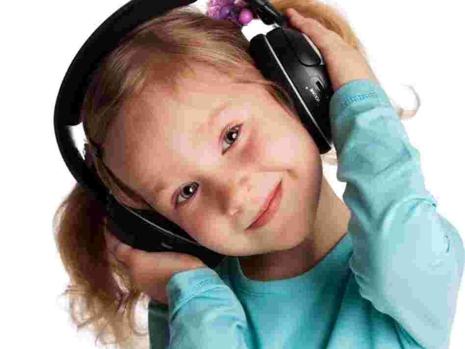 A young girl with headphones on