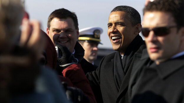 President Barack Obama greets people on the tarmac upon his arrival at Kansas City International Airport.