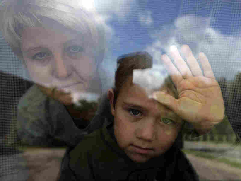 Janina Wasilewski, 41, and Brian, 6, look out one of their few windows in their tiny Polish apartment on Wednesday, Sept. 19, 2007 in Nowe Miasto Lubaswskie.