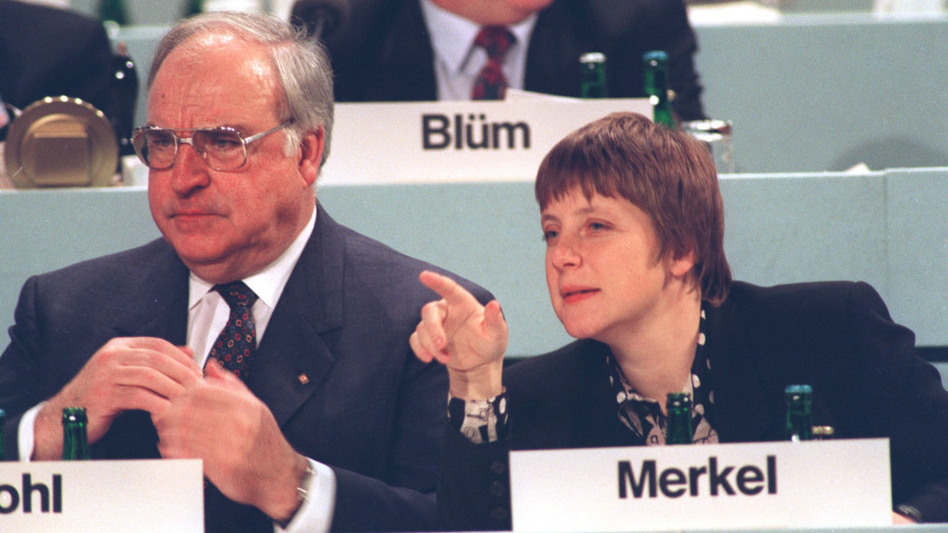 In an undated photo from the early 1990s, Merkel, then Germany's minister for women and youth, is shown beside Chancellor Helmut Kohl. Unlike Kohl, Merkel did not live through World War II and was not shaped by history in the same way as her predecessor.