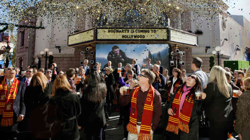 Guests enjoy a Butterbeer toast at the announcement that The Wizarding World Of Harry Potter is coming to Hollywood.