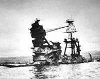 The exposed wreckage of the battleship USS Arizona in 1942; today, most of the ship lies beneath the waves at Pearl Harbor.