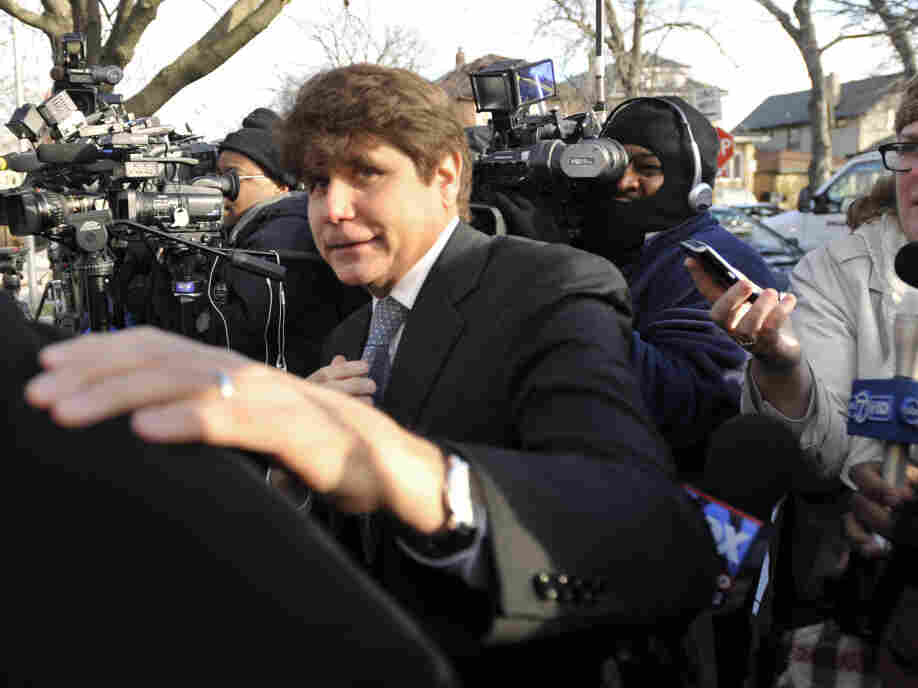 Former Illinois Gov. Rod Blagojevich arrived at his home being sentenced to 14-year prison sentence for a political corruption conviction.