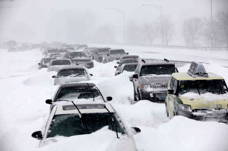 In this Feb. 2 file photo, hundreds of cars are seen stranded on Lake Shore Drive in Chicago after