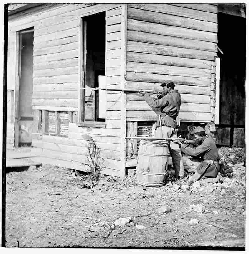 Two black soldiers man a forward watch station in Dutch Gap, Va., during the Civil War. Author Ta-Nehisi Coates says he has become a student of the war — and he's wondering why more black Americans don't join him.