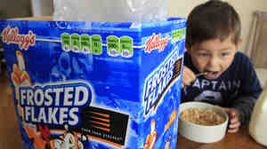 Nathaniel Donaker, 4, eats Kellogg's Frosted Flakes cereal at his home in Palo Alto, Calif. Frosted Flakes is 27 percent sugar, according to a report by the Environmental Working Group.